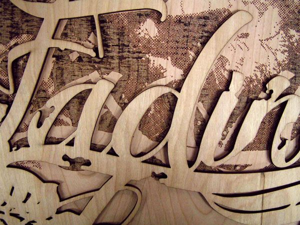 Laser cut and engraved plywood art