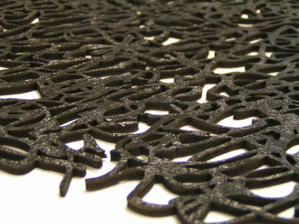 laser cut black leather scribble