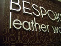 laser etched leather sign w raised acrylic lettering
