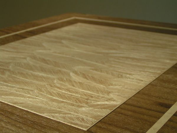 Laser engraved veneer table top