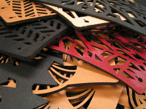 various laser cut leather samples